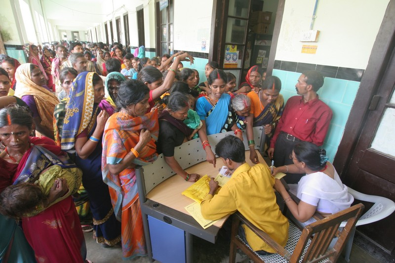 People waiting to get registered at Motihari District Government Hospital in East Champaran, Bihar. With so few doctors employed to work in the public sector of healthcare in India, this scene is typical.